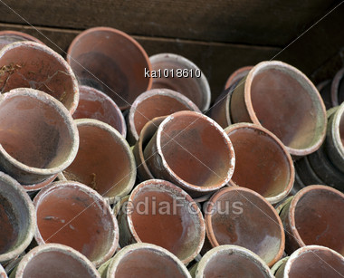 Stacks Of Old Clay Plant Pots In A Victorian Potting Shed Stock Photo