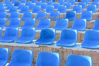 Stadium Blue Chairs At Sun Light Stock Photo