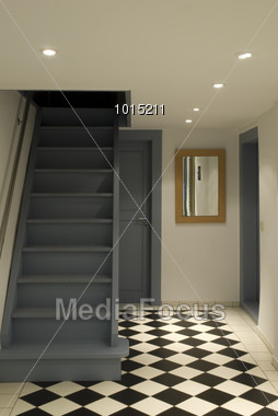 Stairs and Checkered Tiles Stock Photo