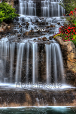 Steams Of Misty Water Fall Down The Hill In High Dynamic Range Stock Photo