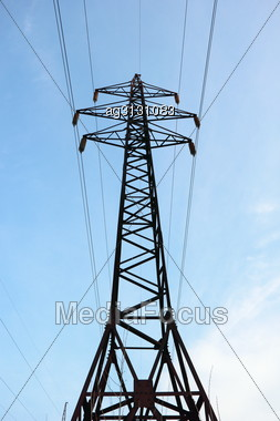 Steel Structure Supports The Wires That Transmit Electrical Current, High Voltage Stock Photo