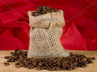 Still Life With Bag Of Coffee On Red Background Stock Photo