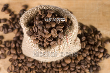 Still Life With Bag Of Coffee On Wooden Background Stock Photo