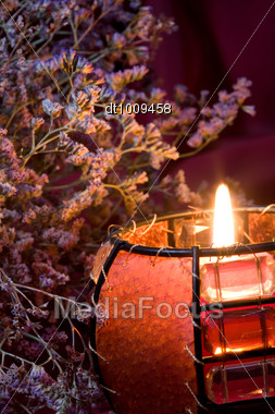 Still-life With Burning Candle And Heather Stock Photo