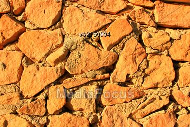 Stone Background At Sun Light. Stone Texture Stock Photo