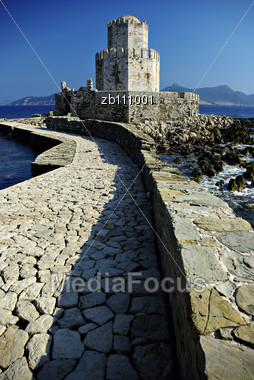 Stone-paved Stretch Leads Over A Small Bridge To The Small Fortified Islet Of Bourtzi And Spectacular Sea Gate Stock Photo