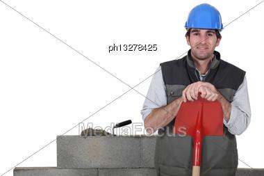 Stonemason Standing Proudly Next To His Work Stock Photo