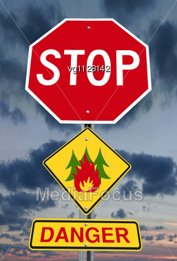 Stop Sign With Forest Fire Icon And Danger Warning Over Dark Sky Stock Photo