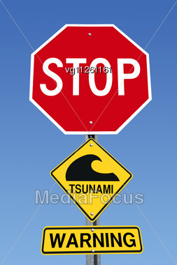 Stop Sign With Tsunami Icon And Warning Over Blue Sky Stock Photo