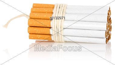 Stop Smoking Concept. Cigarettes Tied With Rope And Wick Isolated On White Stock Photo
