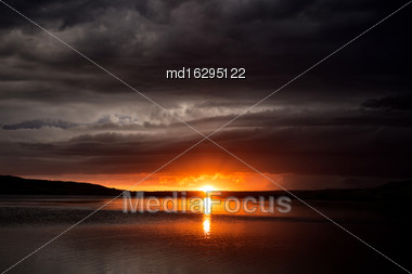 Storm Clouds Lake Sunset In Saskatchewan Canada Stock Photo