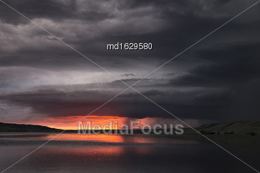 Storm Clouds Lake Sunset In Saskatchewan Canada Stock Photo