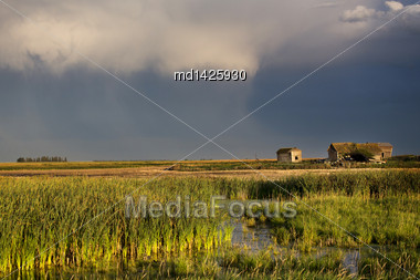 Storm Clouds Saskatchewan And Abandoned Farm House Stock Photo