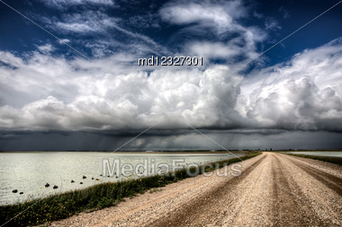 Storm Clouds Saskatchewan Billowing Clouds And Gravel Road Stock Photo