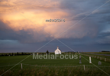 Storm Clouds Saskatchewan With Country Church And Sunset Stock Photo
