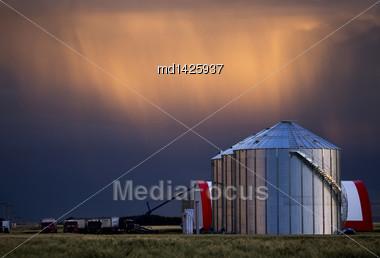 Storm Clouds Saskatchewan And Farm Storage Granary Stock Photo