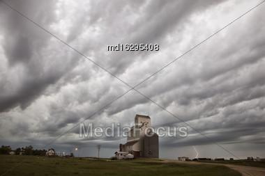 Storm Clouds Saskatchewan Grain Elevator And Lightning Stock Photo