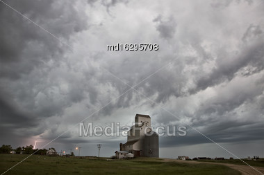Storm Clouds Saskatchewan Grain Elevator And Lightning Stock Photo