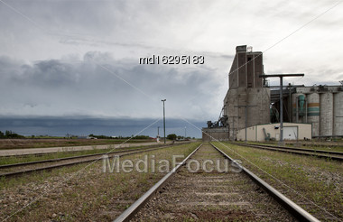 Storm Clouds Saskatchewan Grain Elevator Train Tracks Stock Photo