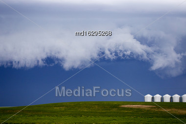 Storm Clouds Saskatchewan Granaries In A Row Stock Photo