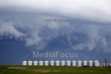 Storm Clouds Saskatchewan Granaries In A Row Stock Photo