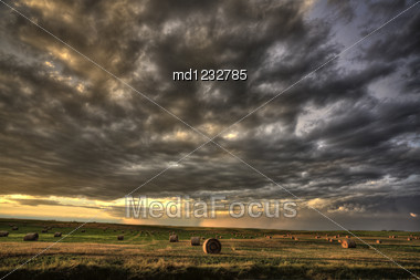 Storm Clouds Saskatchewan Hay Bales In Canada Stock Photo