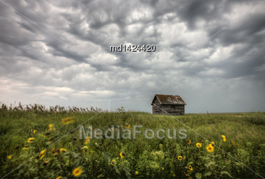 Storm Clouds Saskatchewan With Old Farmhouse And Lightning Stock Photo