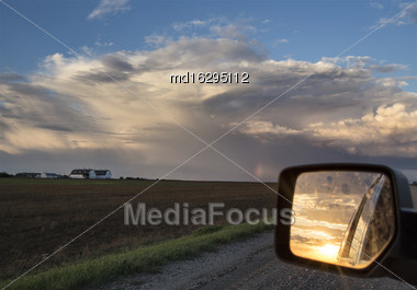 Storm Clouds Saskatchewan Prairie Mirror Reflection Sunset Stock Photo
