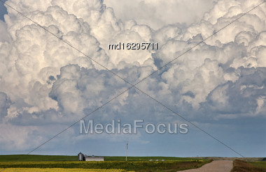 Storm Clouds Saskatchewan Thunderhead Billowing Over Farm Land Stock Photo