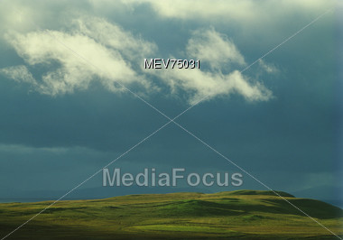 Stormy Clouds Over Valley - Scotland, Great Britain Stock Photo