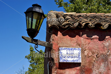Street Lamp Plate Plant And A Wall In Calle De Los Suspiros Of House In Colonia Del Sacramento Uruguay Stock Photo