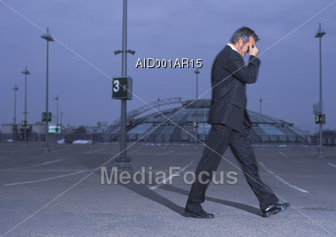 Stressed Business Man Thinking and Walking Stock Photo