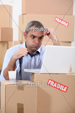 Stressed Warehouse Worker Stock Photo