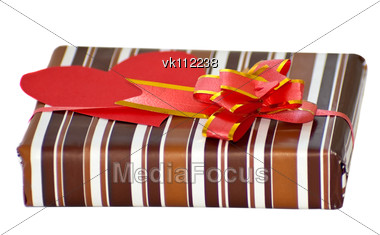 striped box with ribbon and heart shaped paper note for text Stock Photo