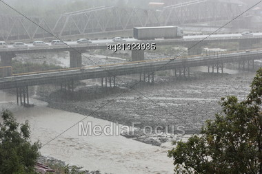 Strong Rain Caught Unawares People And Cars On The Bridge Of The Southern Of The City Stock Photo