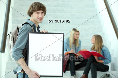 Student Holding Blank Poster Stock Photo