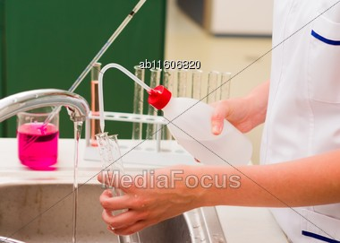 Student Rinsing Test Tubes At Chemical Laboratory Stock Photo