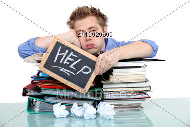 Student Swamped Under Work Stock Photo