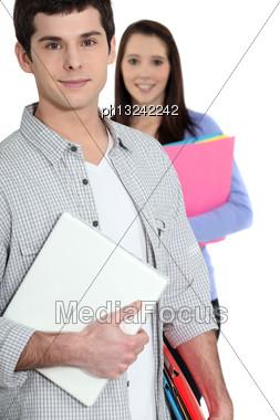 Students Holding Folders Stock Photo