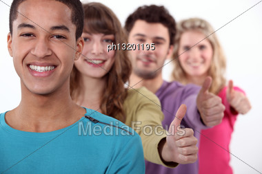 Students In A Row Giving The Thumb Up Stock Photo