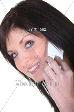 Studio Closeup Of A Woman Using A Cellphone Stock Photo