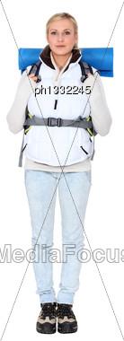 Studio Portrait Of A Female Backpacker Stock Photo