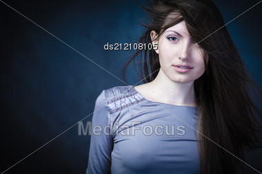 Studio Portrait Of Woman With Long Hair Stock Photo