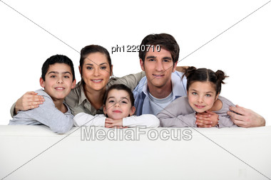 Studio Shot Of A Young Family Stock Photo