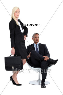Studio Shot Of A Smart Business Duo Stock Photo