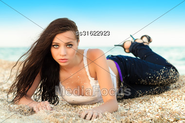 Stunning Young Brunette Posing On The Beach Stock Photo