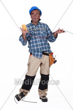 Stupid Electrician Stock Photo