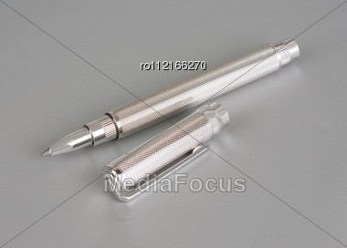 Stylish Ballpoint Pen Of White Gold On A Grey Stock Photo