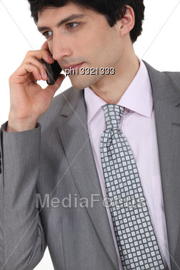 Successful Businessman Making A Call Stock Photo