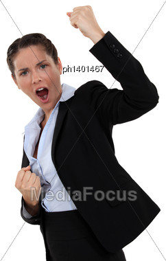 Successful Businesswoman Screaming And Raising Hands Stock Photo